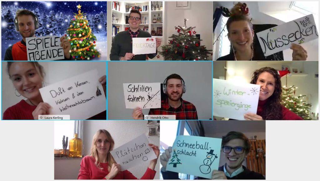Das achtköpfige Team von VisionGesund hält jeweils einen weißen Zettel in die Kamera. Die Aufnahme entstand bei einem digitalen Meeting. Auf den Zetteln stehen die Dinge, auf die wir uns an Weihnachten freuen.
